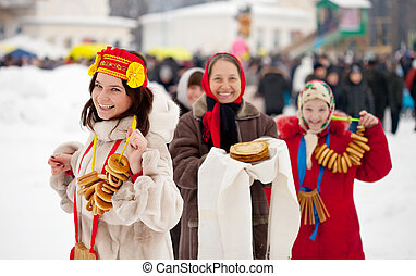 Women with pancakes during Maslenitsa festival in Russia