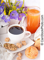 Breakfast from coffee with rolls, juice on delicate...
