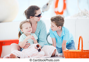 Mother and kids at luxury yacht - Beautiful mother and her...