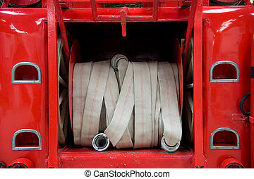 Firehose in red firetruck - Rolled up firehose at the back...