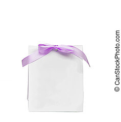 Blank note with puple bow isolated on white