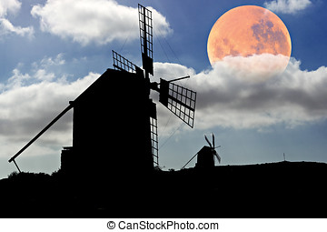 Moon setting over Spanish Windmills at Fuerteventura, Canary...