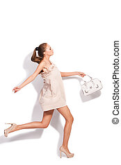 elegant run - young woman in elegant short dress and high...