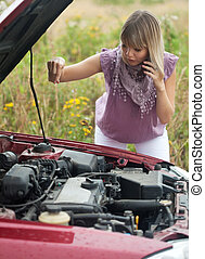 woman with her broken car - young woman with her broken car...