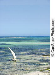 Dhow on turquoise lagoon