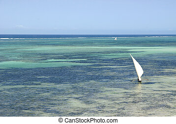 Typical dhow on turquoise lagoon