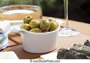 Stuffed Olives - Green olives stuffed with red pimento in...