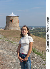 in the hometown - portrait of the girl against the ancient...