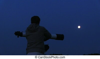 astronomer - silhouette of telescope and astronomer
