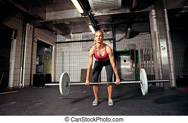 Deadlift - Female crossfit performing doing deadlift...