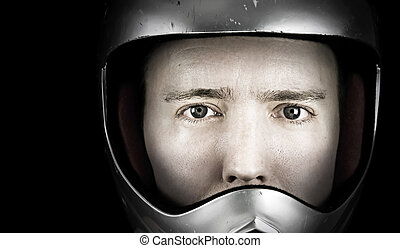 man in crash helmet - man in bike crash helmet on black...
