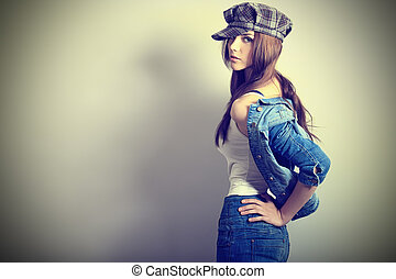 open shoulder - Shot of an attractive fashionable girl...