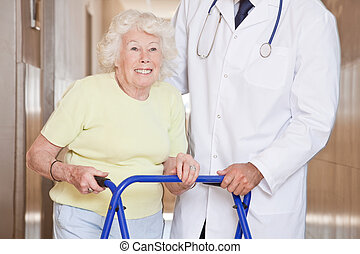 Doctor and Woman with Zimmerframe - Portrait of elderly...