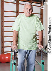 Senior Man having ambulatory therapy