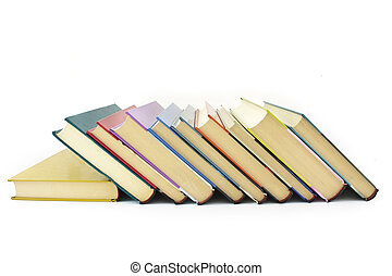 pile of color books - pile of color hardcover books over...
