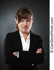 Suspicious businesswoman - Businesswoman with an expression...