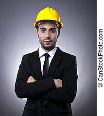 Young investor with construction helmet - Young investor in...
