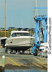 Power boat at ramp - Big white luxury power boat prepared...