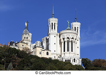 famous Lyon basilica in the blue sky