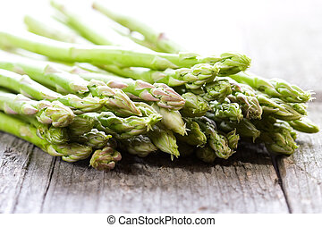 fresh asparagus on wooden table