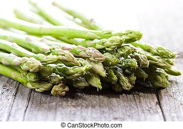 fresh asparagus on wooden table