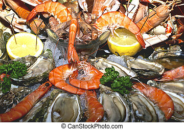assorted seafood - assorted prepared seafood with lemon and...