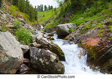 waterfall in rocky Altai mountains