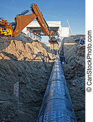 pipeline at construction site - Excavator set steel pipe in...