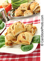 Puff pastry - savory pastry snacks filled with red pepper...