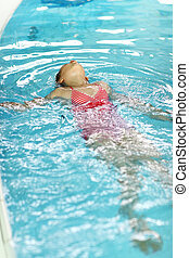 Swimming backstroke - Schoolchild swimming backstroke in the...