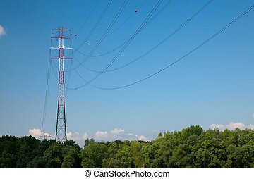 Electric line - Extraordinary tall electric tower at a river...