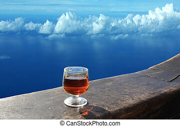 Have a drink in heaven - A glass of alcoholic drink on a...