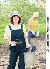 women fertilizes the soil