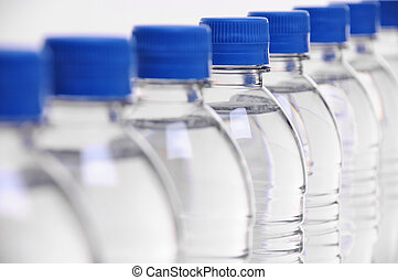 water bottle lids blurred - select focus on middle bottle in...