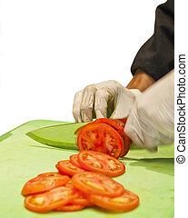 Chef Slicing Tomatoes restaurant
