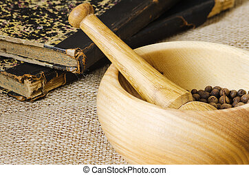 Mortar - Wooden mortar and pestle with black pepper