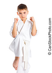 Aikido boy fighting position in white kimono isolated on...