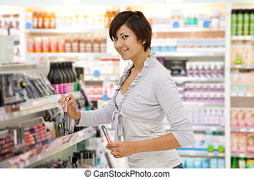 girl at cosmetics shop - girl buying cosmetic at cosmetics...
