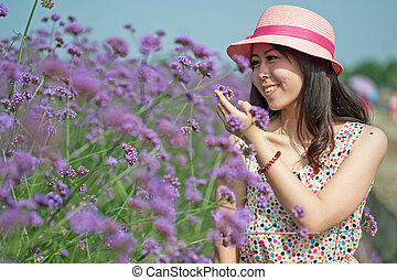 A Chinese young women playing in the vast lavender