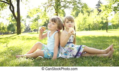 Children eating ice cream. Sitting