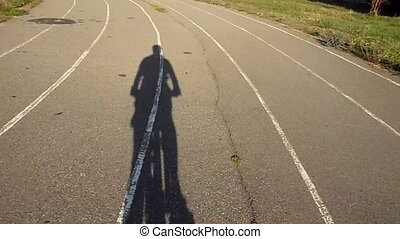 Bicyclist - Shadow bicyclist on the stadium track
