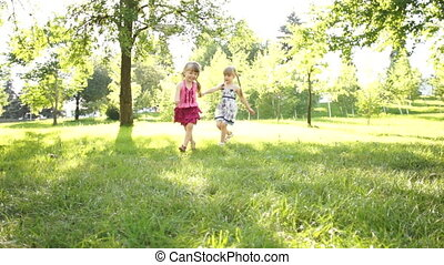 Two girls running - Children outdoors