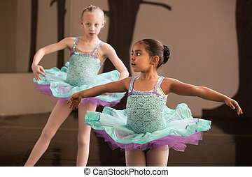 Cute Ballet Students Twirling - Two adorable children...