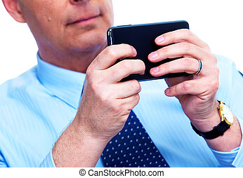 Businessman calling by phone.