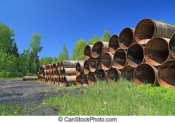old gas pipes amongst green herb