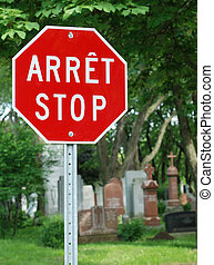 Stop sign in French and English languages - Red stop sign...