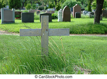 Wood Cross in cemetery - Simple wooden cross in an outdoor...