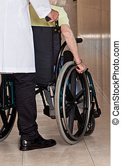 Doctor with Patient on Wheel Chair - Doctor with patient on...