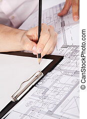Architects Hand on Clipboard