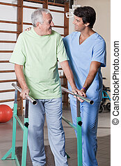 Senior Man having ambulatory therapy - Senior man having...